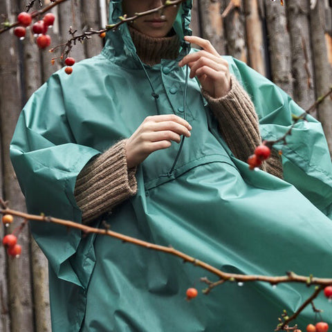 A new wet-weather friend, the Mono Rain Poncho is made in lightweight, water-resistant fabric and features a drawstring tie and peaked hood for superior protection. It packs easily into the front pouch and is available in different colours.