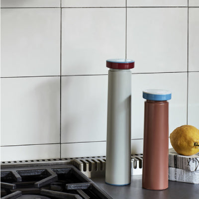 George Sowden's colourful salt and pepper mills are made from stainless steel and feature a ceramic grinder that enables you to adjust the size and coarseness of the salt or pepper grain. Available in two different heights in a choice of colours.