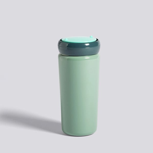 Contrasting colours make for a playful expression in George Sowden's Travel Mug. Crafted in stainless steel with a plastic lid, the functional design is suitable for containing hot and cold drinks.