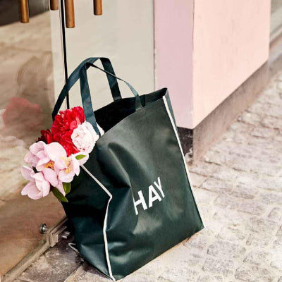Strong enough to carry grocery shopping and spacious enough for a weekend away, Hay's shopping bag is a useful and versatile everyday item. crafted in durable and lightweight recyclable polypropylene.