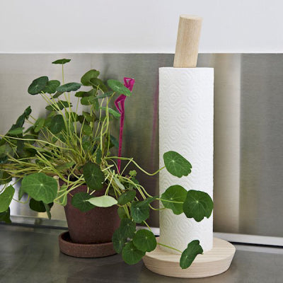 Porter is an ingenious wooden kitchen roll holder that allows you to put a kitchen roll on a straight rod, and lock it in place by twisting the top of the rod, which also doubles as a handle