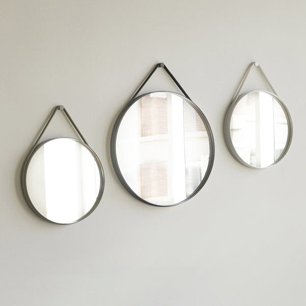 Based on the concept that restraint is best, Strap Mirror has kept the design stripped to a clean, circular shape. Strap features a groove around the edge to contain a sturdy rubber strap that is used to mount the mirror on the wall. With its functional and minimalistic design, Strap Mirror is perfect for hanging in bedrooms and halls and not suitable for wet rooms.