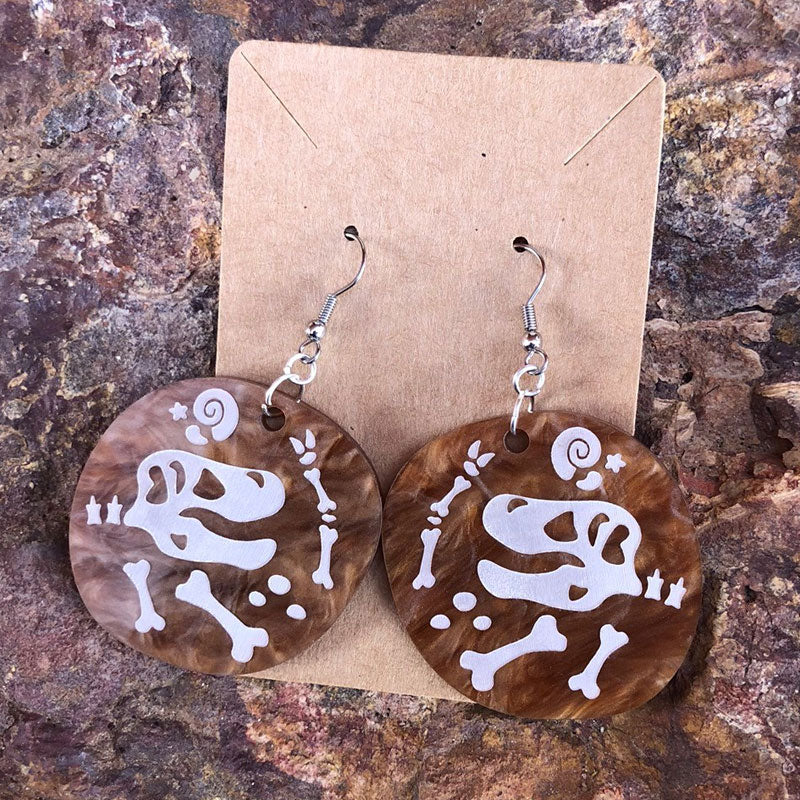 Dinosaur excavation earrings