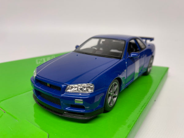 Nissan Skyline R34 GT-R . Blue . 1/24 Scale . Welly . Boxed .