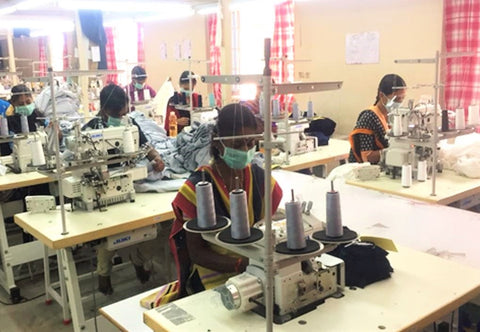 women sewing cotton baby clothes
