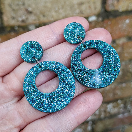 Guns n Posies Medium Circle Acrylic Earrings Turquoise Glitter