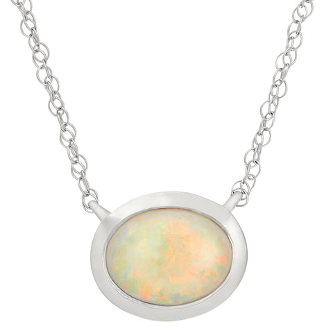 Oval Shaped Bezel Set Opal Pendant in 14K