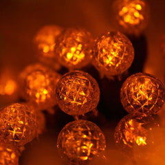 "70 Amber/Orange G12 LED String Lights, Green Wire, 4"" Spacing"