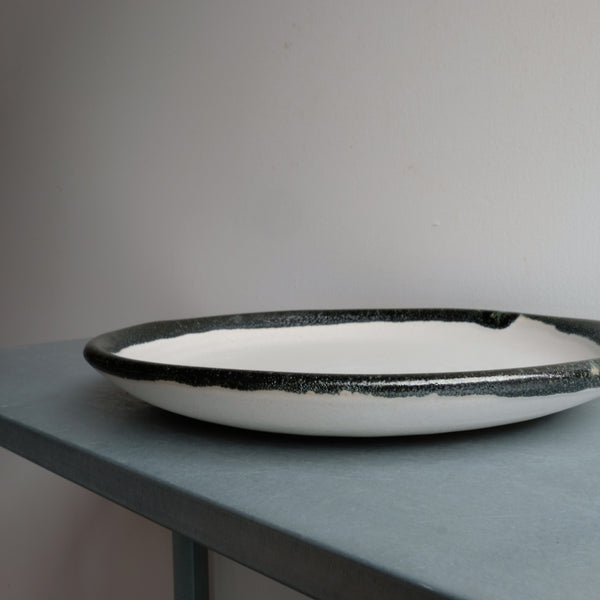 Plate in Bone With Black Fringe
