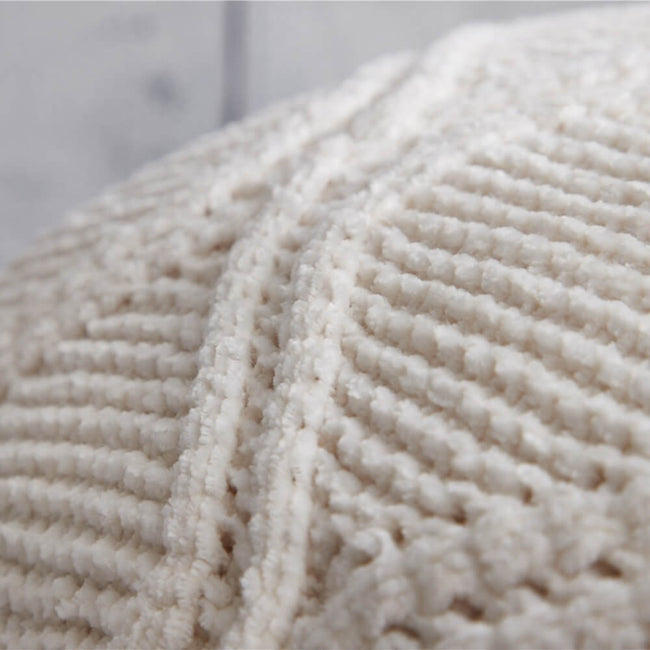 White hygee knit pom-pom blanket up close
