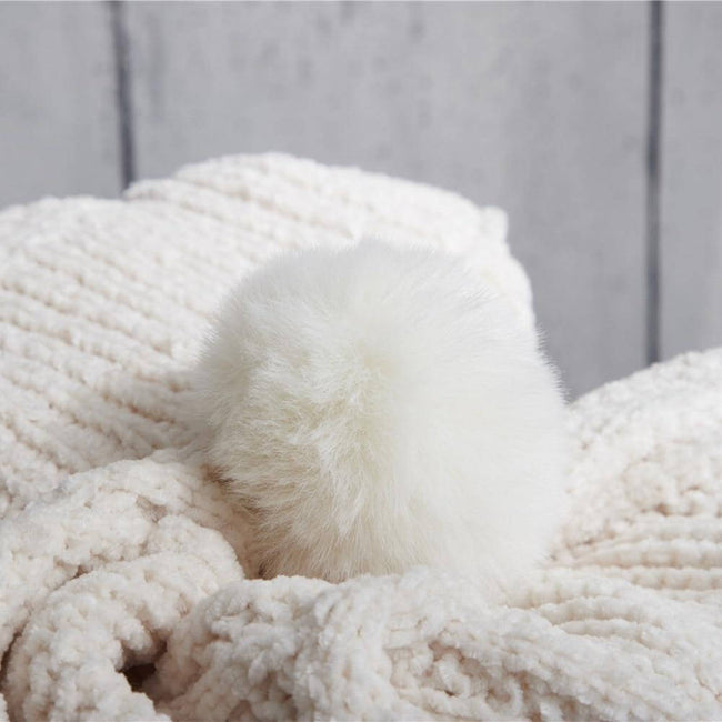 White hygee knit pom-pom blanket up close of pom-pom