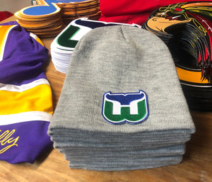 Beanie (Grey) with a Whalers crest / logo $35