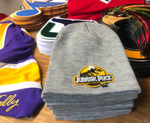 Load image into Gallery viewer, Beanie (Grey) with a Jurassic Puck crest / logo $29