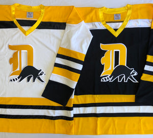 "Custom hockey jerseys with a ""D"" embroidered twill logo"