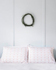 Oh Mabel Blush Printed Organic Cotton Pillowcases On Bed 2