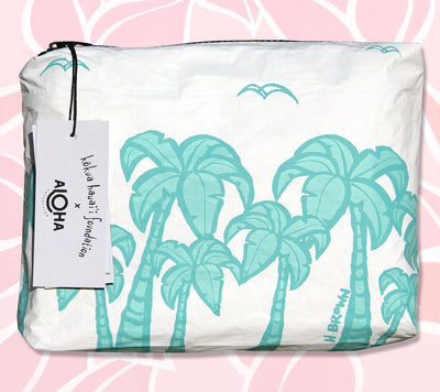 The ALOHA Collection Clutch with artwork by Hawaii Tropical Artist Heather Brown and created by ALOHA Collection and Kōkua Hawaiʻi Foundation