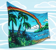 "The ""Ānuenue"" sarong/pareo is a limited release item for Summer 2018 and features a classic Hawaiian rainbow arching over a tropical landscape."