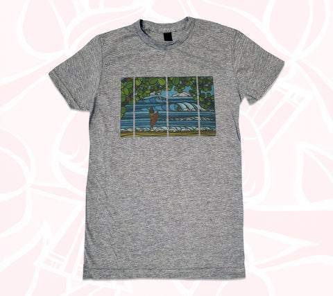 Women's charcoal shirt printed with an idyllic surfing scene by Hawaii artist Heather Brown