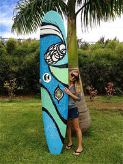 "Heather Brown with her new, limited edition 8'11"" single fin ""Sea Siren Surfboard."""