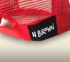 Red color mesh/bill with an H Brown patch on the back.