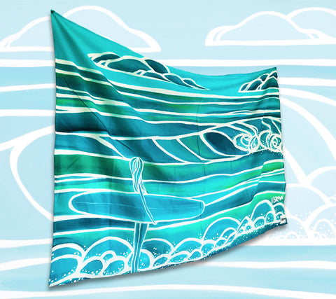 "The ""Spring"" sarong/pareo is a limited release item for Summer 2018 and features a monotone seascape with a surfer girl out to catch the perfect wave."