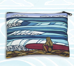 Surf Girl Beach Clutch - Featuring a surfer girl sitting in the warm sand and watching the playful waves by Heather Brown