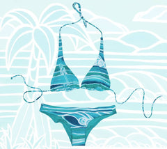 The Surf Trip swimsuit top and bottom, showing a peaceful surf scene in shades of blue.