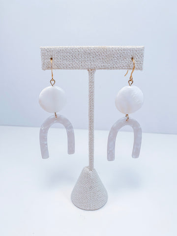 white U earrings