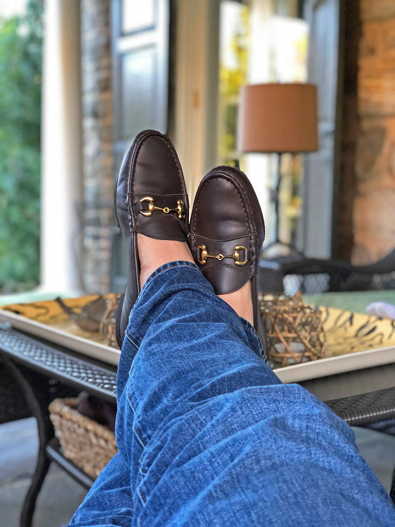brown bit loafers on table - will cyphers in their shoes