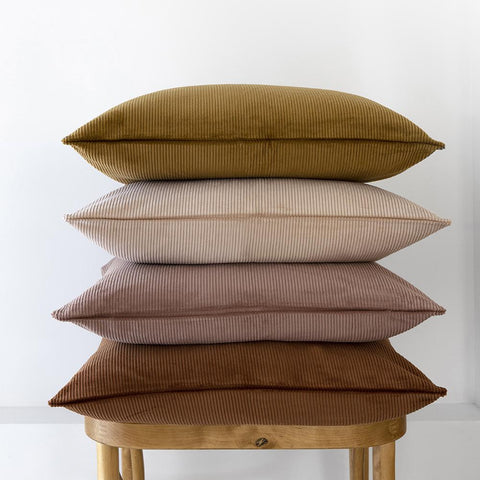 Beautiful stack of Bambury corduroy cushions in earthy colour tones