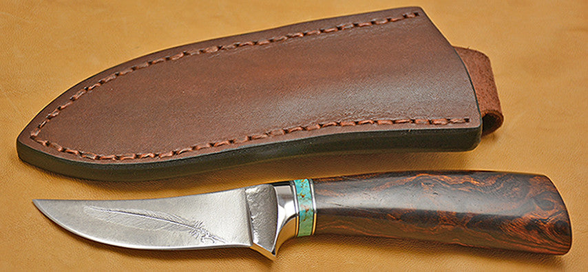3 inch Trailing Point Skinner with 'Feather' Etching.