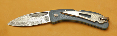 Boye Sunburst Lockback Folding Knife with 'Lighthouse and Sailboats' Etching.