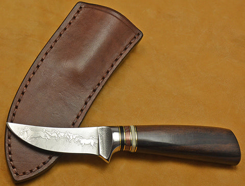 3 inch Trailing Point Skinner with 'Mustangs' Etching and Macassar Ebony Handle.