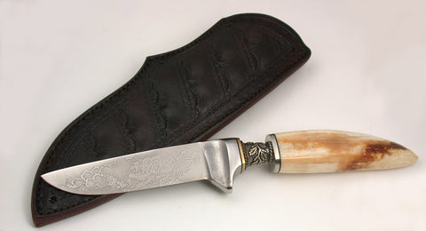 4 inch Dropped Point Hunter with 'Grizzly' Etching.