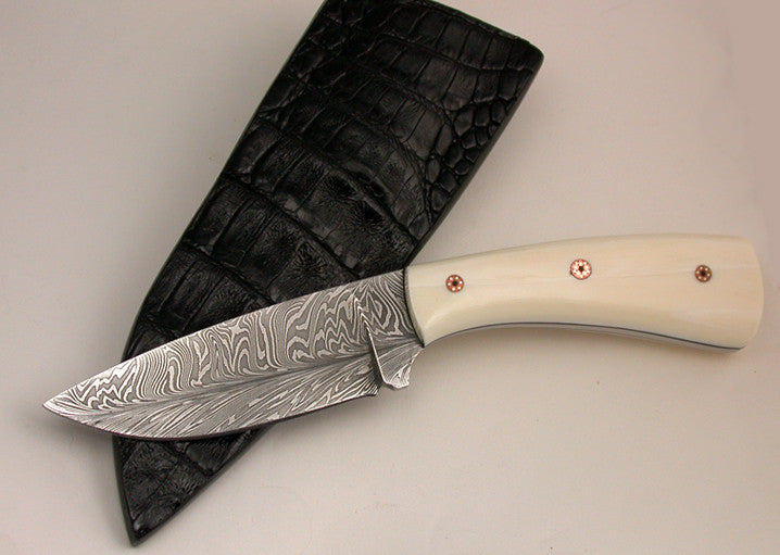Oz Knives 4 inch Damascus Drop Point with Fossil Walrus Handle.