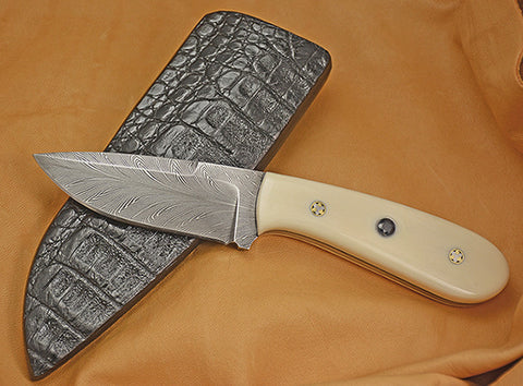 Oz Knives 4 inch Damascus Drop Point with Fossil Walrus Handle and Inlaid Blue Sapphires.