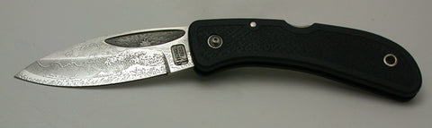 Boye Sunburst Lockback Folding Knife with 'Tsunami' Etching.