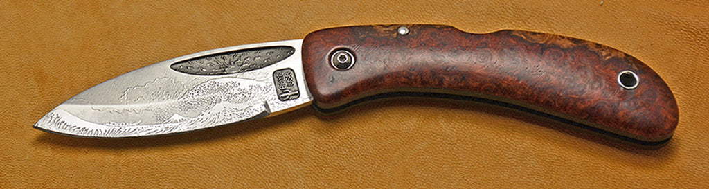 Boye Custom Sunburst Lockback Folding Pocket Knife with 'Tsunami' Etching and Amboyna Burl Handle.