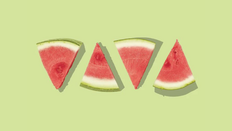 Four slices of watermelon on yellow backgorund