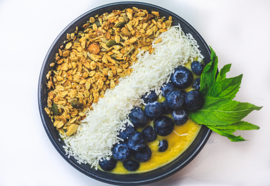 A mango bowl with different fruits and nuts