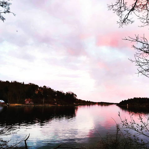 Pink clouds over peaceful lake