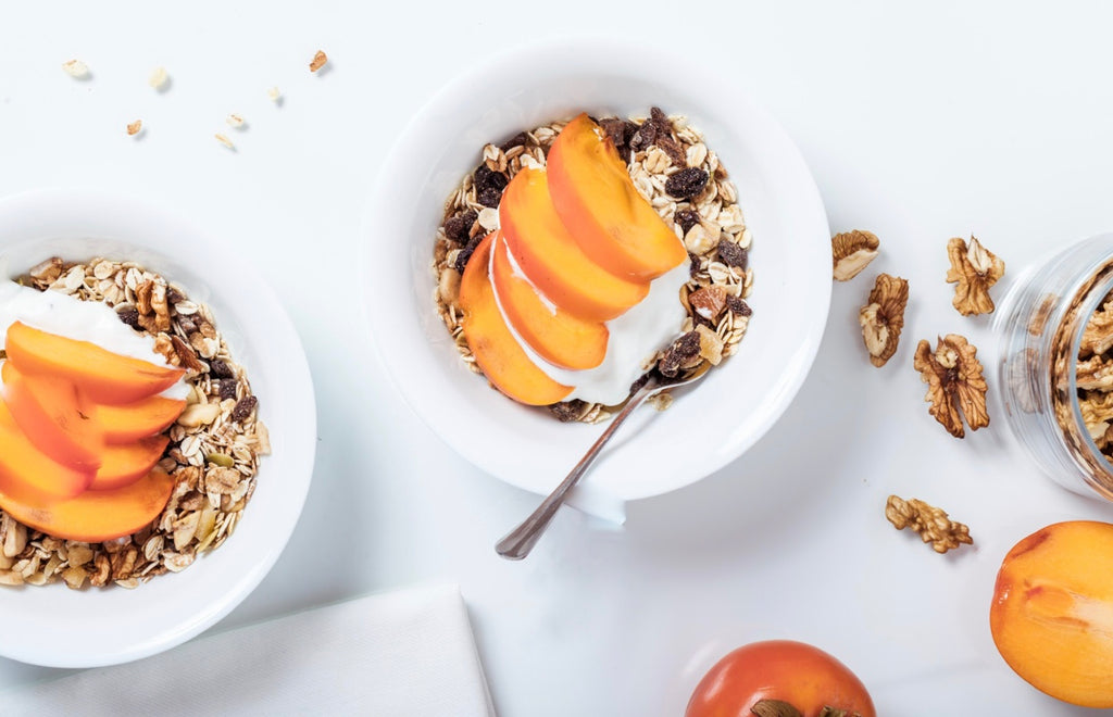 breakfast bowls with fruits and seeds on the white surface