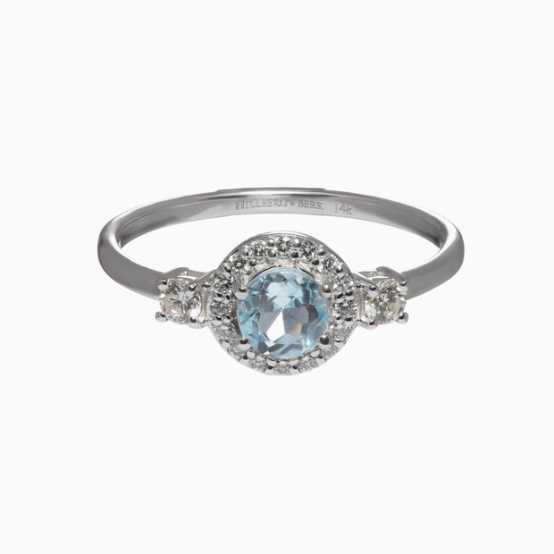Round Sky Blue Topaz and Diamond Halo Ring in 14K White Gold