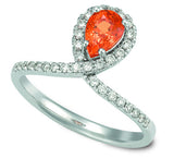 Exclusive Pear Spessorite Garnet and Diamond Ring