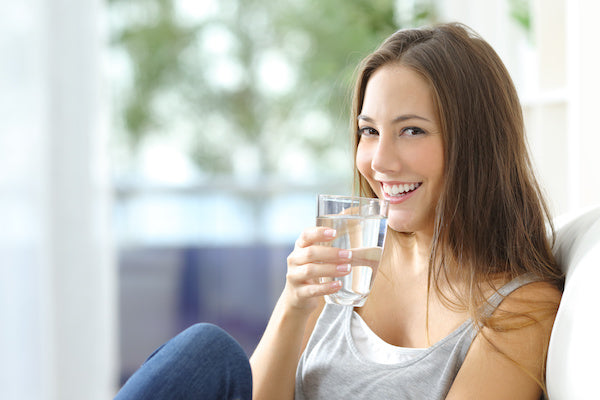 Happy Woman Drinking Purified Water