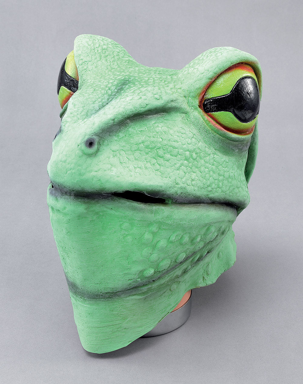 A full face rubber mask of a green frog with yellow eyes