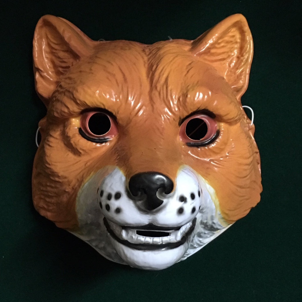 A plastic fox mask that covers the front of the face