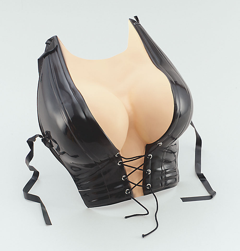 Plastic breasts with low cut black leather corset to be attached to chest.