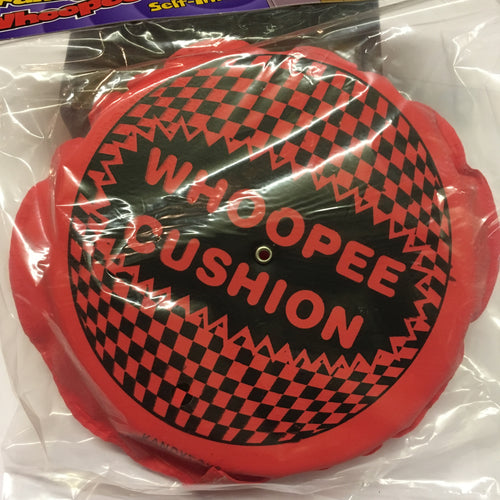 pink self inflatable plastic with text 'whoopee cushion'