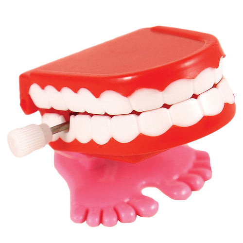 Small plastic set of teeth, red with white teeth, that you wind up. They have small feet and hop as they chatter.